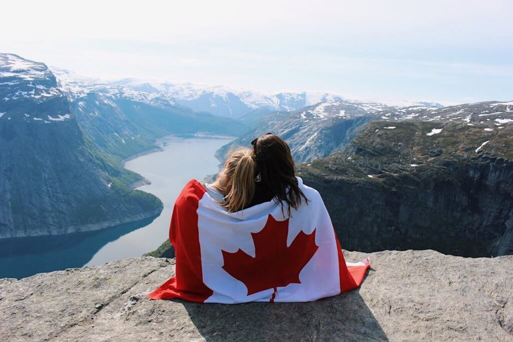 Rachelle with a friend and the Canadian flag