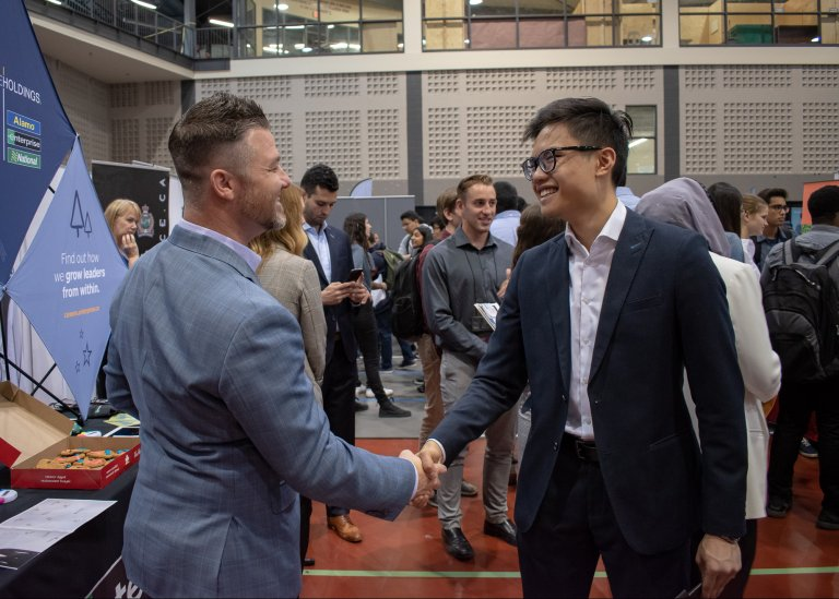 Student and employer shaking hands at Career Fair