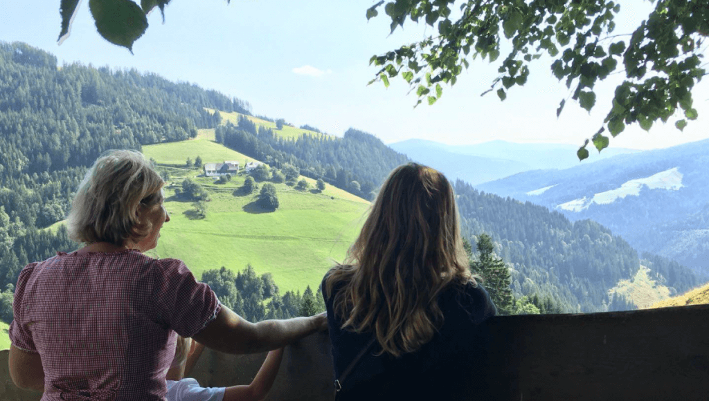 Patricia and a member of the host family looking at a landscape