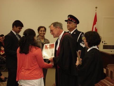 Manveetha receiving her citizenship certificate