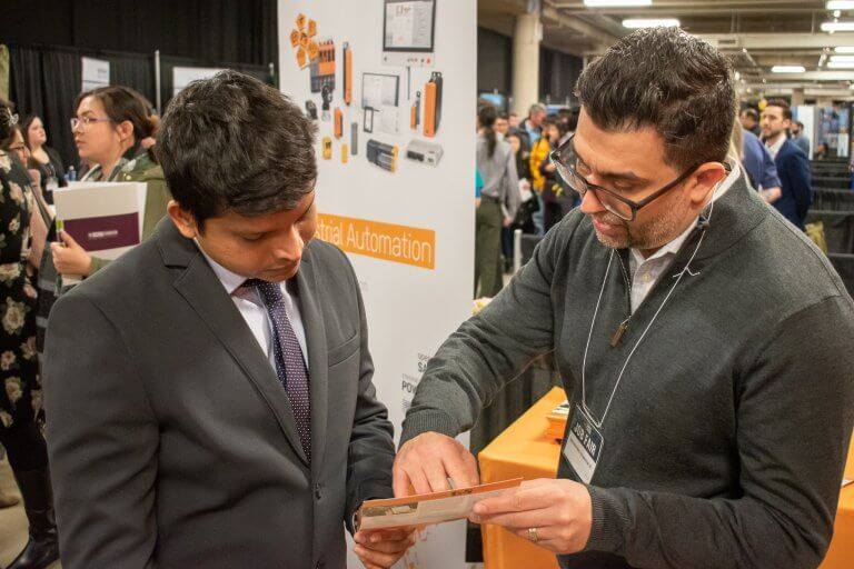 Student and employer connecting at a job fair