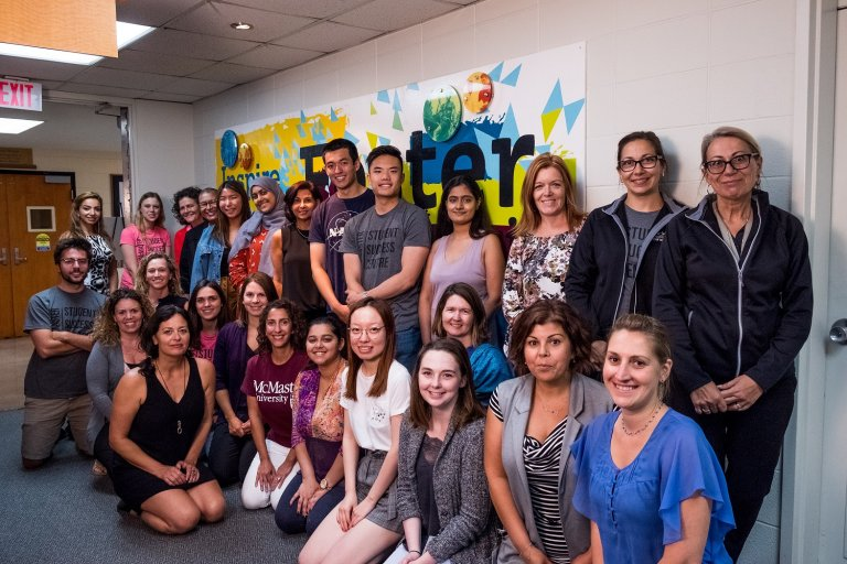 Staff and students with the Student Success Centre mural