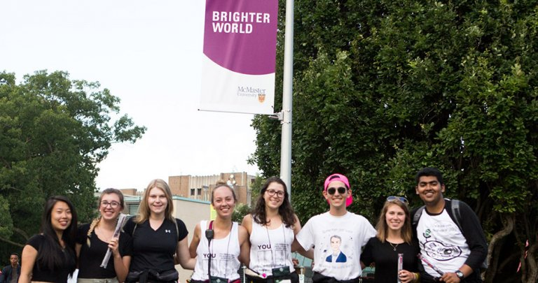Students under a brighter world sign