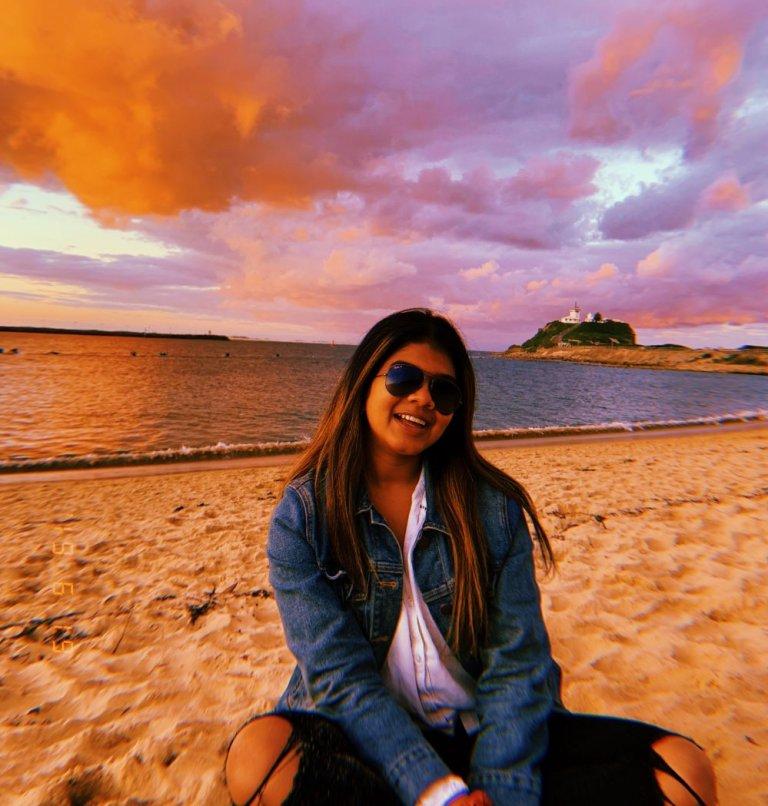 Rhea on the beach at sunset in Australia