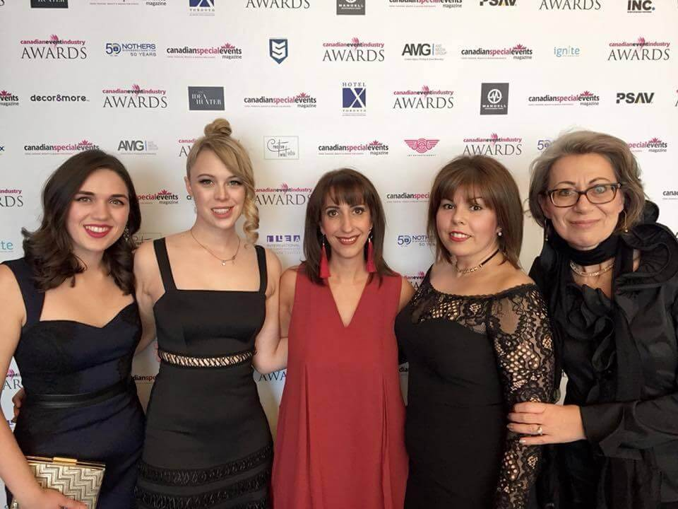 Five student success centre staff at the event industry awards
