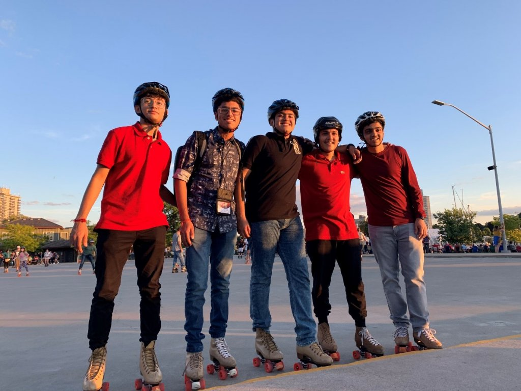 Preet rollerskating with friends at the waterfront