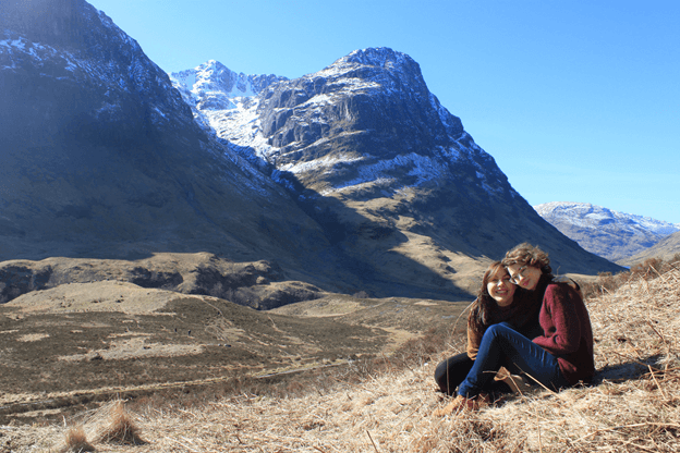 Sabrina and a friend surrounded by mountains