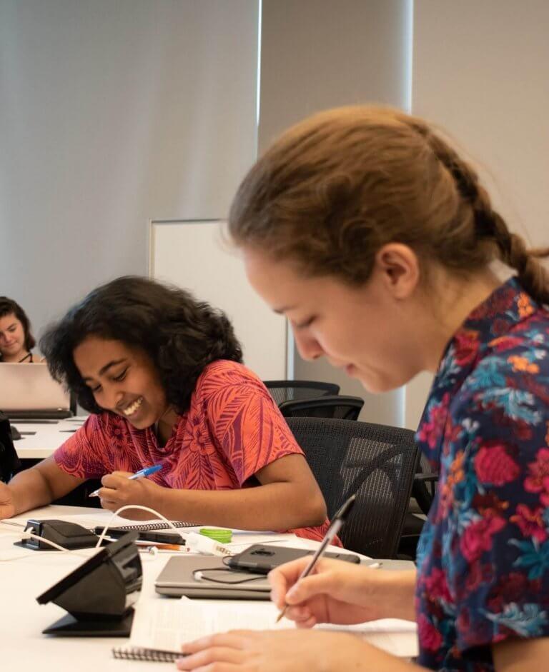Students writing at the Summer Writing Program
