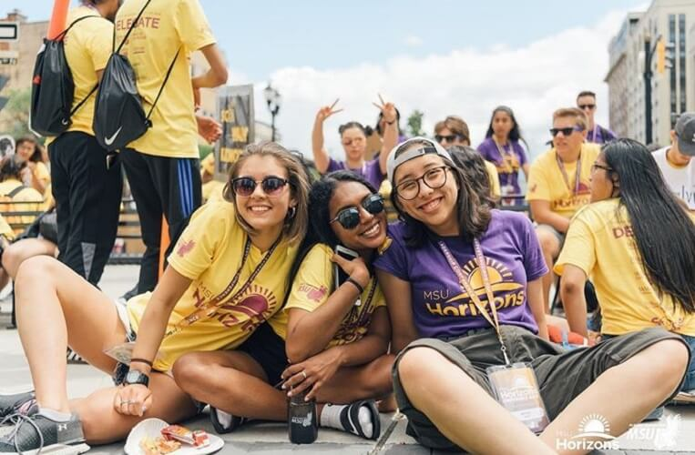 Three students wearing MSU horizons shirts