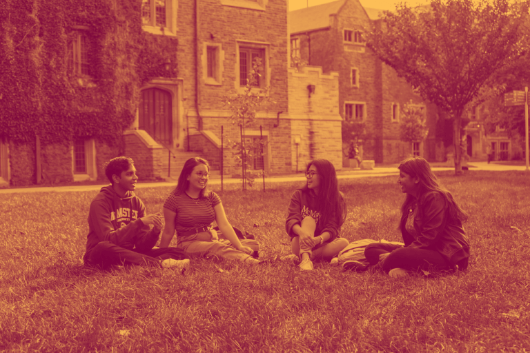 Students on a field of grass at McMaster