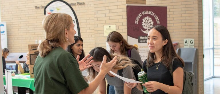 Student and representative at volunteer fair