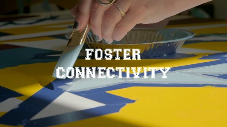 """Mural painting, text reads """"foster community"""""""