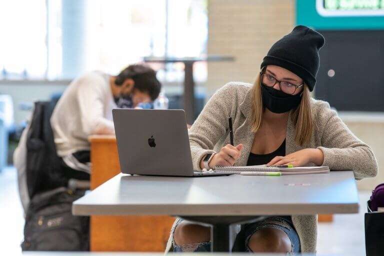 Students studying in MUSC during mid terms October 2020. Wearing McMaster branded face masks.