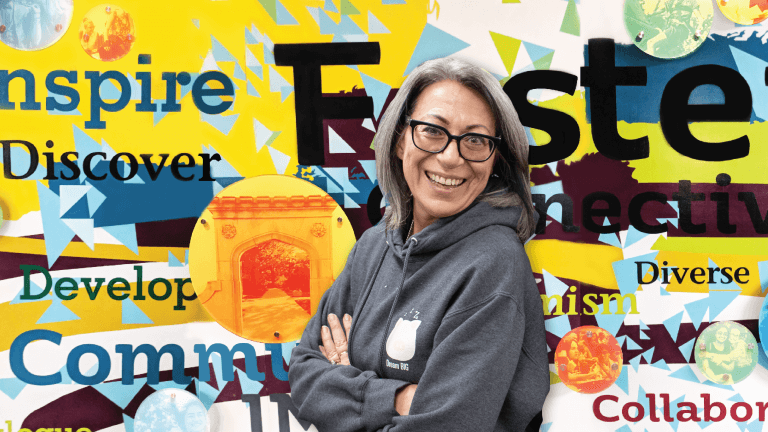 Gina Robinson, SSC director and associate dean of Student Affairs with the SSC mural background.