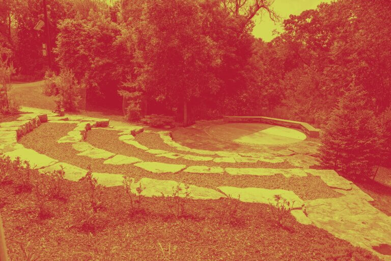 Indigenous Learning Circle shot in summer. Green and red duotone.